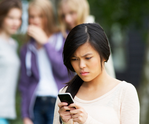 girl texting on phone